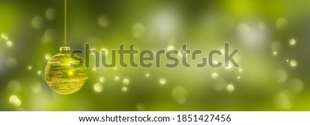 golden christmas ball at the edge of festive blurred green background, christmas lights on abstract beautiful xmas backdrop, empty x-mas background concept Royalty-Free Stock Photo #1851427456