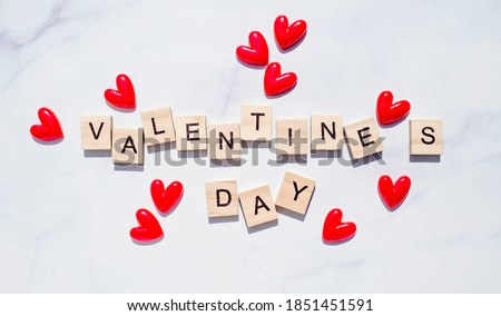 "Banner.The word ""Valentine's Day"". Love on wooden blocks. Theme of love. Wooden letter blocks. Loving, positive emotions. Wooden cubes with the word. An exclusive relationship. Royalty-Free Stock Photo #1851451591"