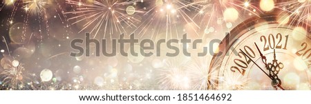 Happy New Year 2021 - Abstract Defocused Background - Clock And Fireworks Waiting Midnight #1851464692