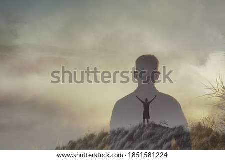 Young adventurous man on top a mountain feeling free, and happy in nature. double exposure  Royalty-Free Stock Photo #1851581224