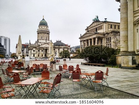 Gendarmenmarkt Square with German Cathedral and Konzerthaus building in center of Berlin city, Germany. The Gendarmenmarkt hosts one of Berlin's most popular Christmas markets Royalty-Free Stock Photo #1851604096