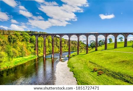 River bridge outdoors in summer. High bridge over outdoor river. River bridge view. High river bridge landscape #1851727471