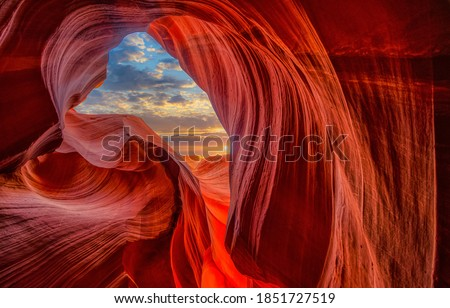 Cave light in abstract naturally red sandstone rock mountains Royalty-Free Stock Photo #1851727519