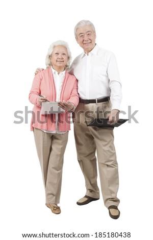 Senior couple holding questionnaire
