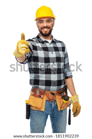 profession, construction and building - happy smiling male worker or builder in helmet and goggles showing thumbs up over white background Royalty-Free Stock Photo #1851902239