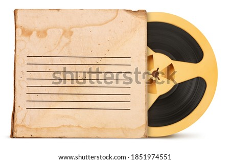 Vintage old magnetic audio tape reel with box isolated on white background Royalty-Free Stock Photo #1851974551