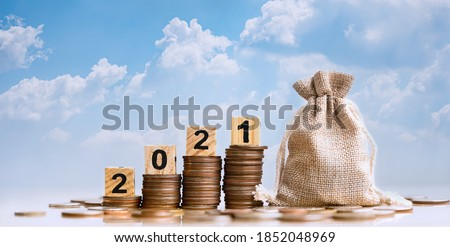 2021 and Coins stack. Pension fund, 401K, Passive income. Investment and retirement. Business investment growth concept. Risk management. Budget 2021. Royalty-Free Stock Photo #1852048969