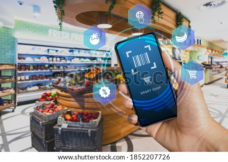 Mobile smart shop device in the checkout counter scan and go. Smart scan that allows customers to scan items from the shelves, pack them in their bag and then leave. #1852207726