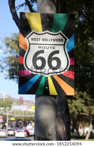 Rainbow Flag West Hollywood Route 66 Sign. A unique Route 66 Highway sign with a Rainbow Flag background. West Hollywood California.