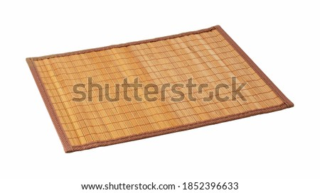 A bamboo luncheon mat on a white background. View from an angle