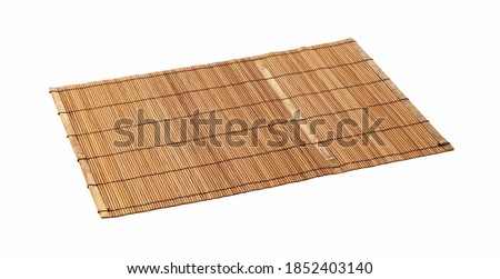 A wooden luncheon mat on a white background. View from an angle