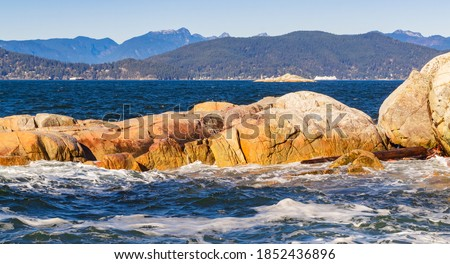 Seascape of the rocky shoreline and ocean waves in the West Vancouver Park BC/Canada. Selective focus, travel photo, npbody. Royalty-Free Stock Photo #1852436896