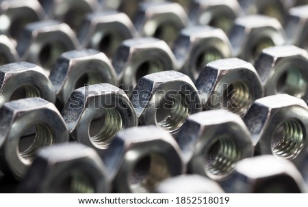 steel fasteners bolt nuts made of high-quality alloy steel and other elements for secure fastening of elements, nuts are used for fixing various elements, close-up nut Royalty-Free Stock Photo #1852518019