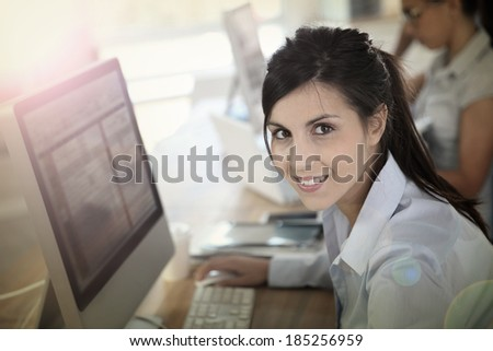 Cheerful young woman attending business training #185256959