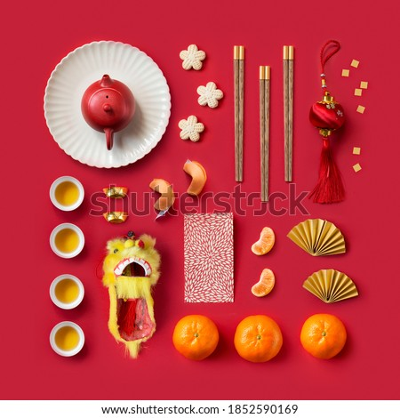 Knolling concepts Chinese New Year objects on red background. Royalty-Free Stock Photo #1852590169