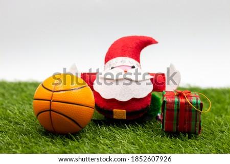 Basketball Christmas with Basketball and Christmas ornament on green grass