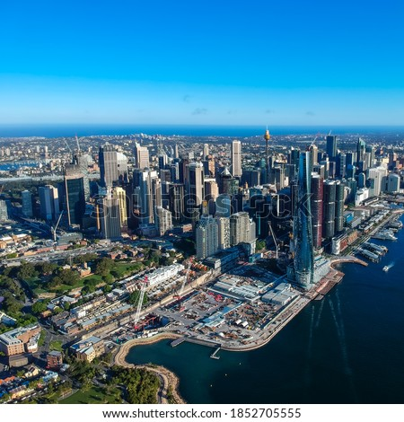 Panoramic Aerial views of Sydney Harbour with the bridge, CBD, North Sydney, Barangaroo, Lavender Bay and boats in view Royalty-Free Stock Photo #1852705555