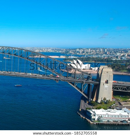 Panoramic Aerial views of Sydney Harbour with the bridge, CBD, North Sydney, Barangaroo, Lavender Bay and boats in view Royalty-Free Stock Photo #1852705558