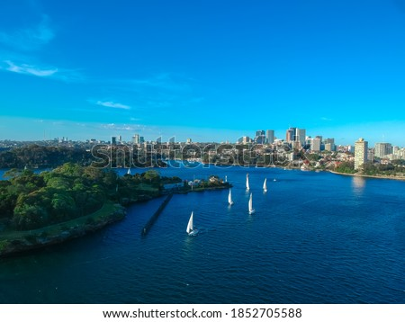 Panoramic Aerial views of Sydney Harbour with the bridge, CBD, North Sydney, Barangaroo, Lavender Bay and boats in view Royalty-Free Stock Photo #1852705588