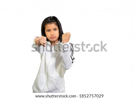Cute sport girl practicing Kung fu  , Chinese martial arts concept. Royalty-Free Stock Photo #1852757029
