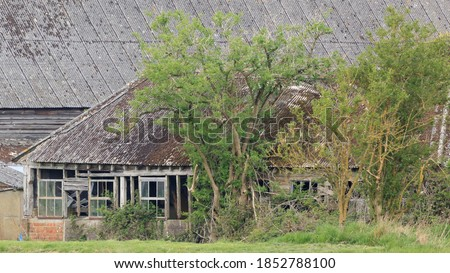 Derelict barns in Oakley, Hampshire, U.K. Royalty-Free Stock Photo #1852788100