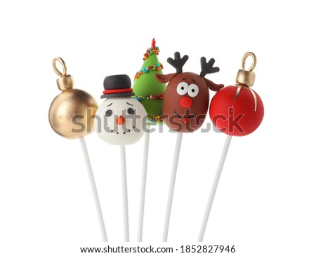 Delicious Christmas themed cake pops isolated on white Royalty-Free Stock Photo #1852827946