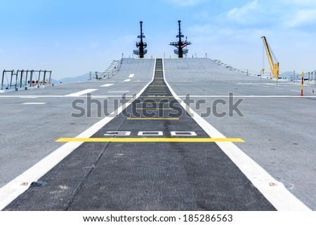 Runway at takeoff on battleship and Runway Aircraft Carrier #185286563