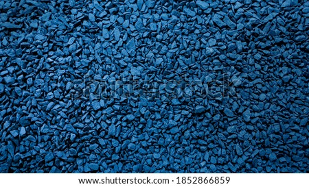 Navy blue dark pebble stone, Abstract style wall background picture pattern, Feeling cool and skin rough.