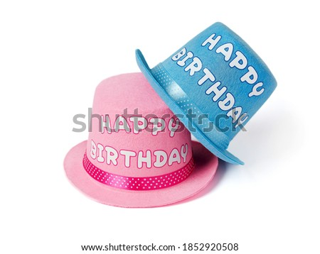 Pink and blue party hats