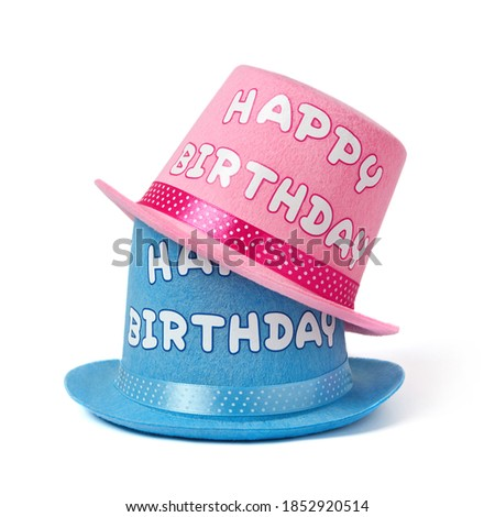 Happy birthday party hats on white background
