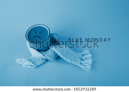 Blue cup with scarfcoffee on blue background. Blue monday concept #1852932289