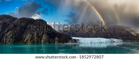 Beautiful Panoramic View of Margerie Glacier in the American Mountain Landscape on the Ocean Coast. Dramatic Sky with Rainbow Art Render. Glacier Bay National Park and Preserve, Alaska, USA. Royalty-Free Stock Photo #1852972807