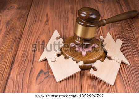 Divorce property division concept. hammer judge, the house is divided by the puzzle. Court law