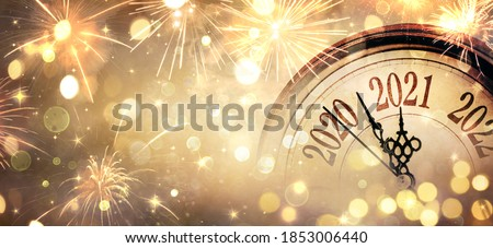 Countdown To Midnight - Happy New Year 2021 - Abstract Defocused Background - Clock And Fireworks  Royalty-Free Stock Photo #1853006440