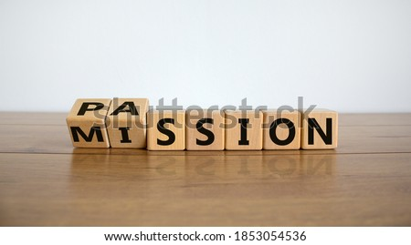 Do your mission with passion. Fliped wooden cubes and changed the inscription 'mission' to 'passion' or vice versa. Beautiful wooden table, white background, copy space. Royalty-Free Stock Photo #1853054536