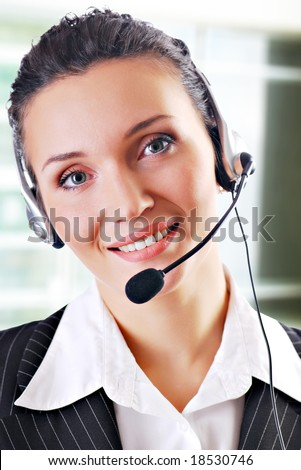 An office executive working as a customer support personnel, wearing a mic headset. #18530746