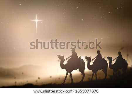 Epiphany and Christmas religious nativity concept: Three wise man against star of cross over night background. Old vintage style tone