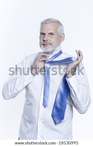 windsor necktie lesson doing by an handsome man #18530995