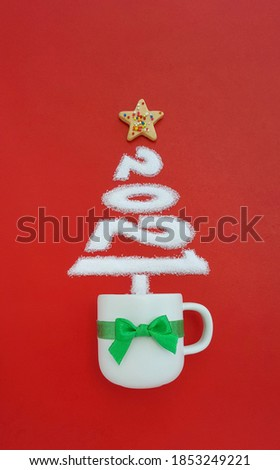Top view 2021 Christmas Tree shape made of sugar, Star cookie above white coffee cup on red background Happy New Year Merry Christmas Theme, Season's Greetings idea image design symbol Flat lay banner