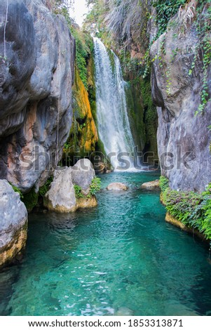 Waterfall with a silk effect on the water in a beautiful natural place Royalty-Free Stock Photo #1853313871