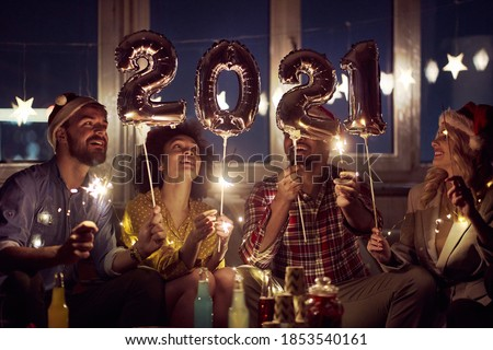 Happy couples waiting for New Year at home party in festive atmosphere. New Year, home party, friends time together #1853540161