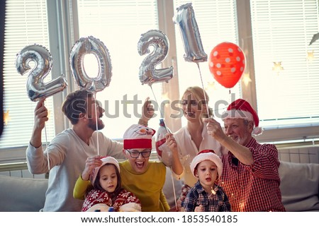New Year eve family gathering at festive home party. New Year, holiday, family time together #1853540185