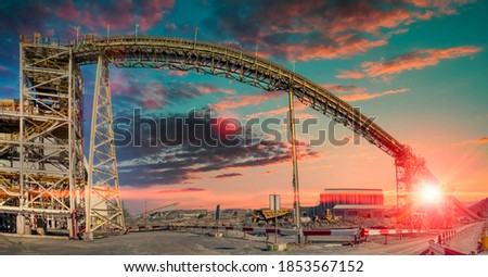 sunset at a huge conveyor belt at a processing plan in a diamond mine in Botswana Royalty-Free Stock Photo #1853567152