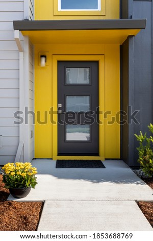 Modern condo entrance with yellow trim Royalty-Free Stock Photo #1853688769