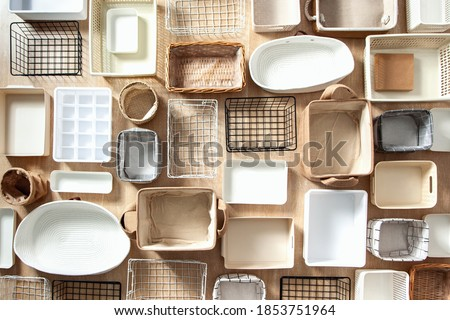 Flat lay of Marie Kondo's storage boxes, containers and baskets with different sizes and shapes for tidying up wardrobe. KonMari method organizer boxes set. Closet organizing concept. Royalty-Free Stock Photo #1853751964