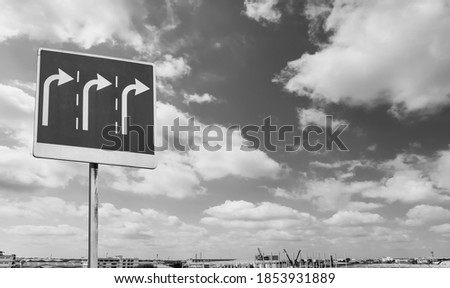 Traffic signs turn right with clouds and sky background