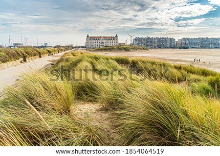 Toeristic pictures of coastcity in flanders Zeebrugge. Zeebrugge in one postcard, beautifull picture of belgium coast like it should be,  seawall for walking with beautiful coast hotel.