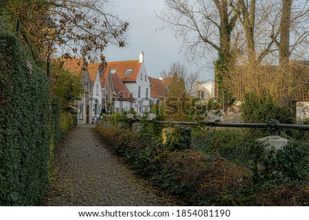 Lissewege a town between Bruges and Knokke.  Idyllic picture of a town.  Beautifull authentic small town with an idyllic atmosphere great for bikers and walkers toerism.  Best of belgium with colours. Royalty-Free Stock Photo #1854081190