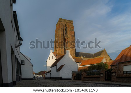 Lissewege a town between Bruges and Knokke.  Idyllic picture of a town.  Beautifull authentic small town with an idyllic atmosphere great for bikers and walkers toerism.  Best of belgium with colours. Royalty-Free Stock Photo #1854081193