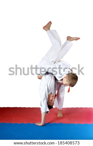 Dressed in a kimono little athletes train throws #185408573